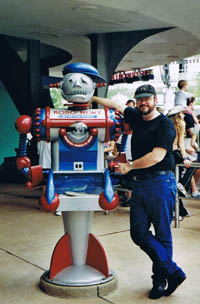 Brad Foster with the Robo News bot at DisneyWorld -photo by Cindy Foster 2002